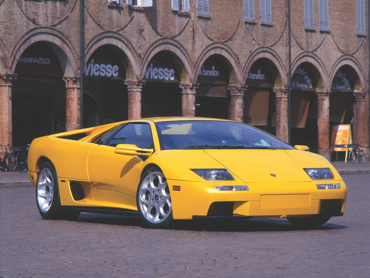yellow lamborghini front three-quarter
