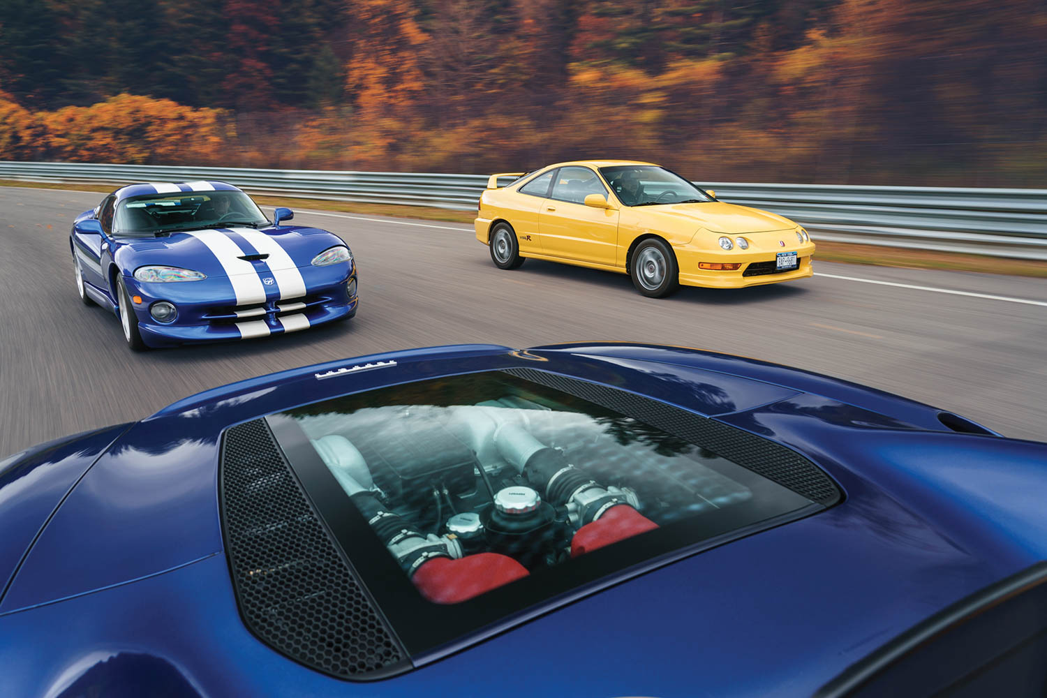 Ferrari under glass: The 360 Spider puts its V-8 in a picture window while being chased by America's own Lamborghini—the Dodge Viper—and the sublime Acura Integra Type R.