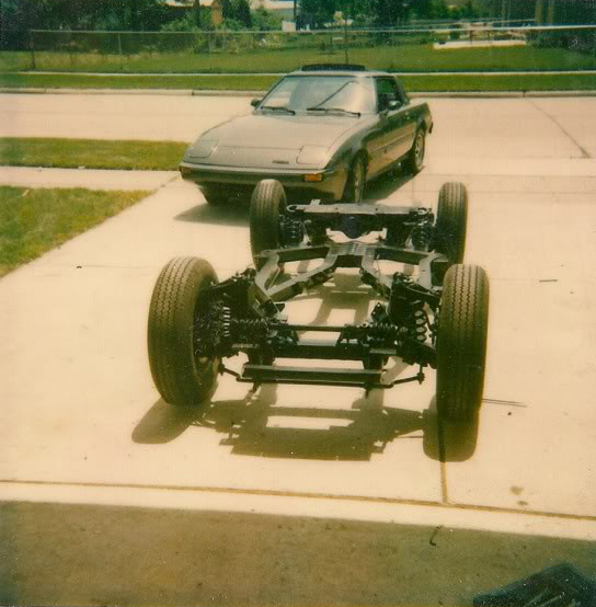 triumph chassis in driveway