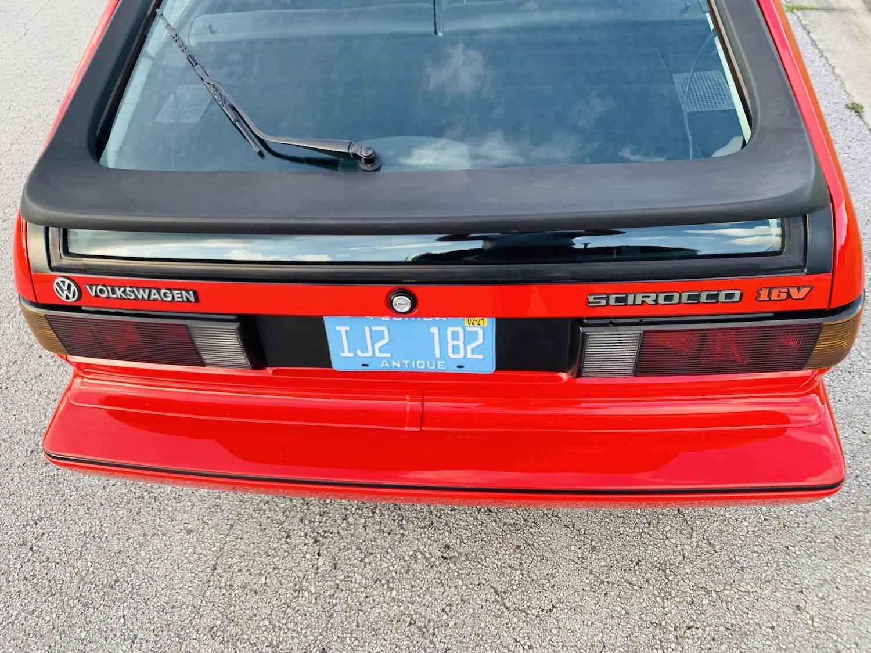red 1986.5 Volkswagen Scirocco 16V rear window