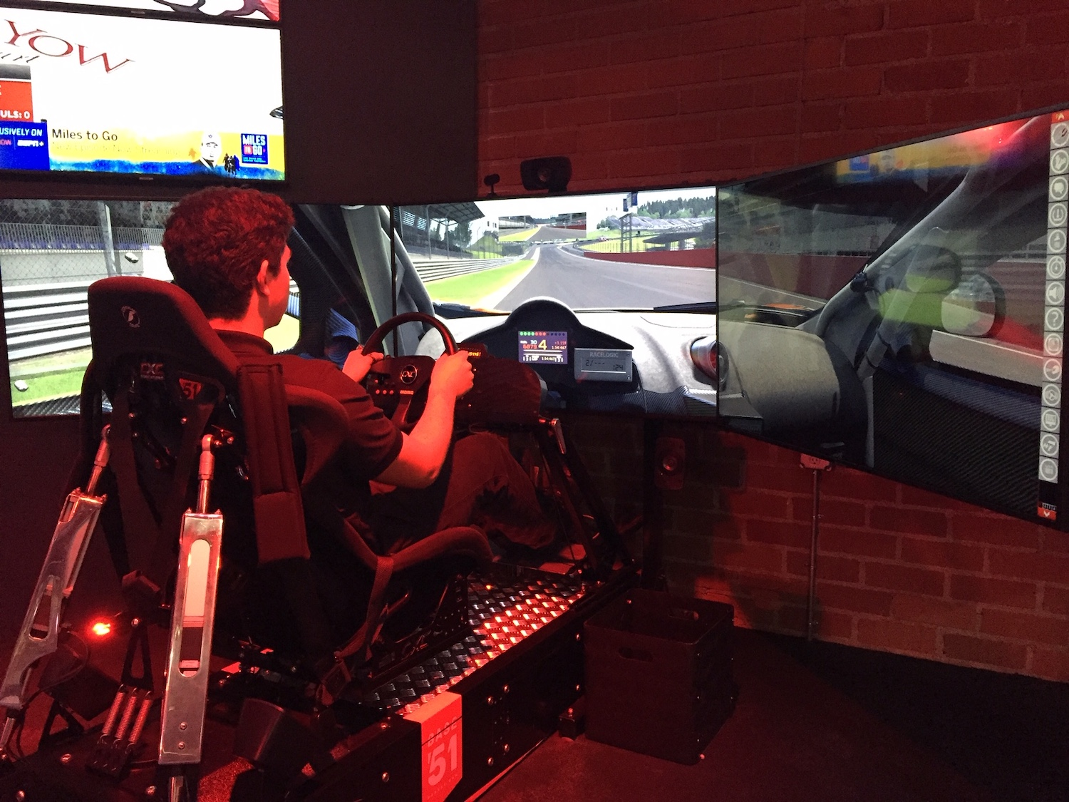 man plays professional racing simulator
