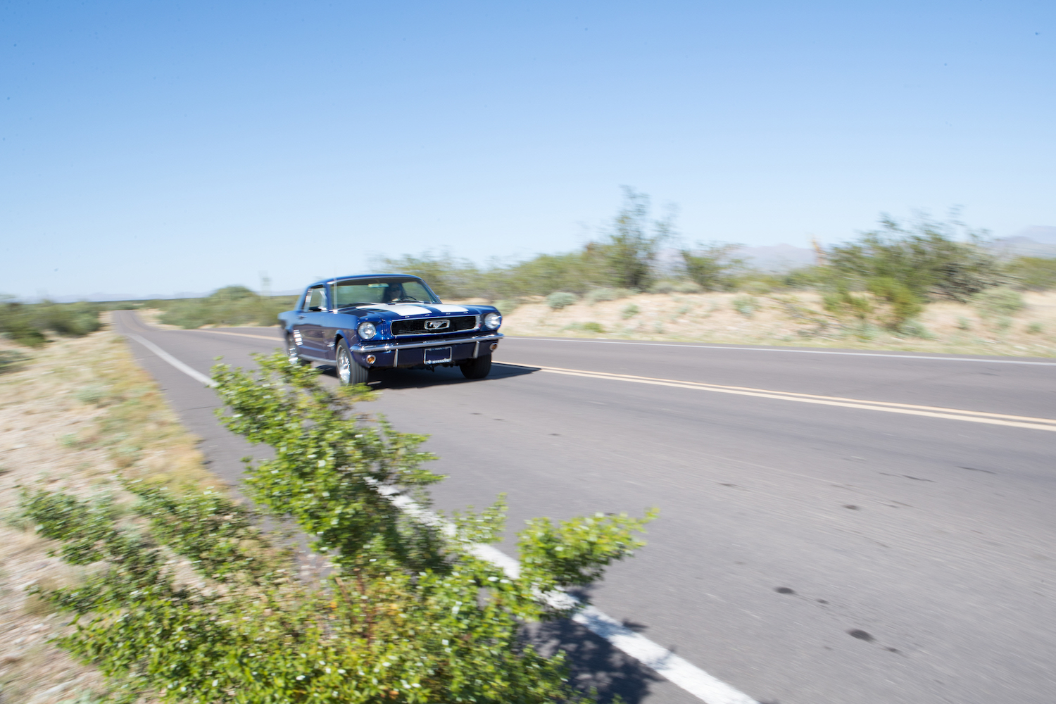 blue mustang front three-quarter action