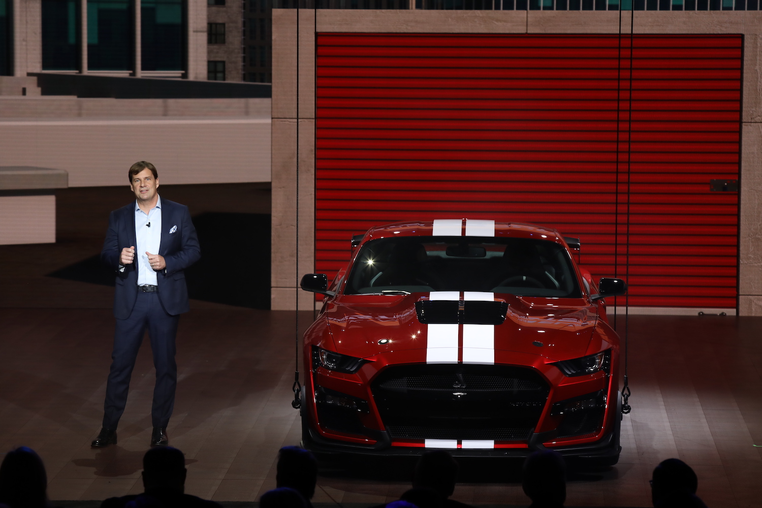 red pony car reveal at auto show