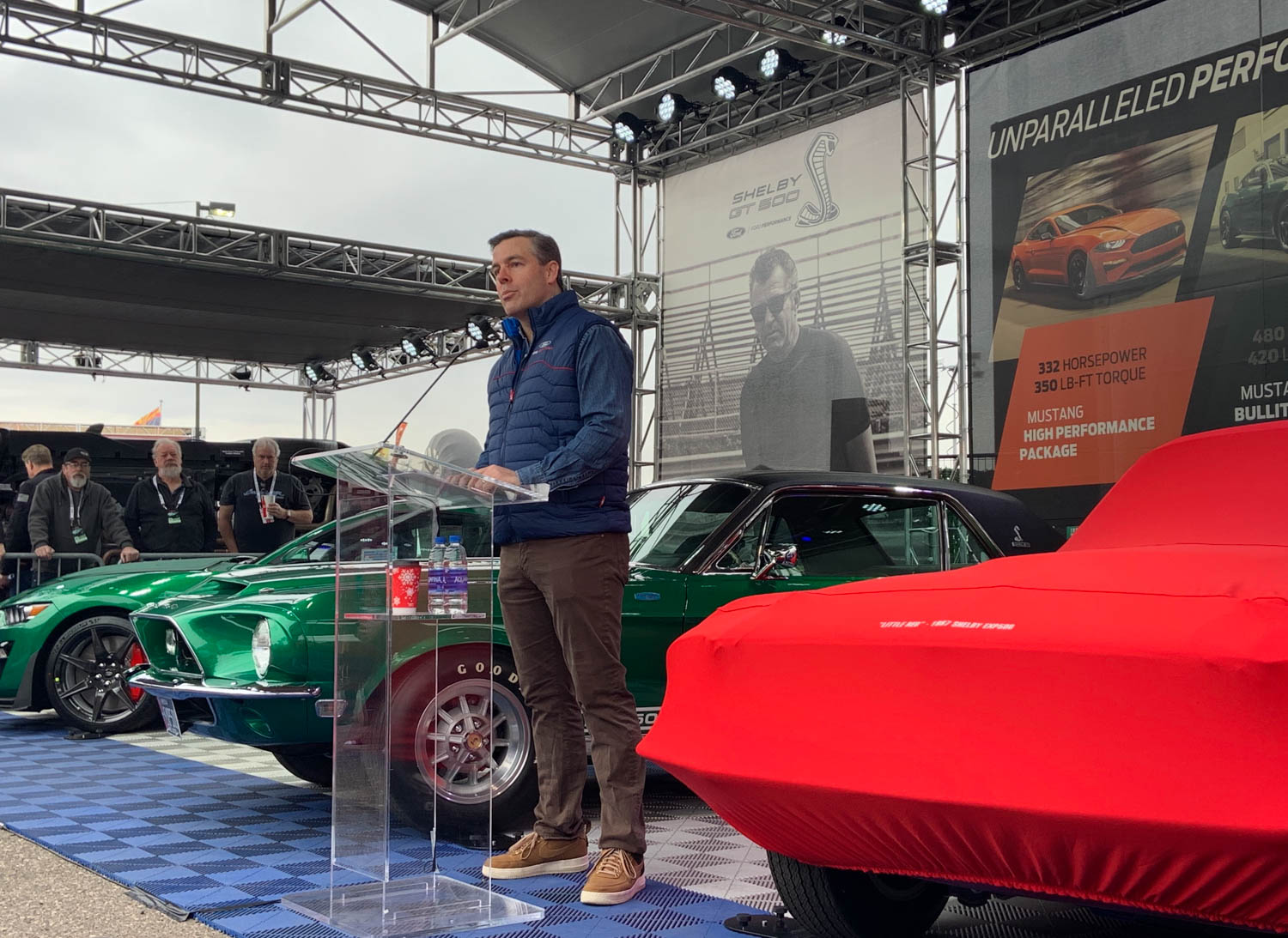 Aaron Shelby, grandson of Carroll Shelby, speaks to the crowd at Thursday's unveiling of the restored Little Red.