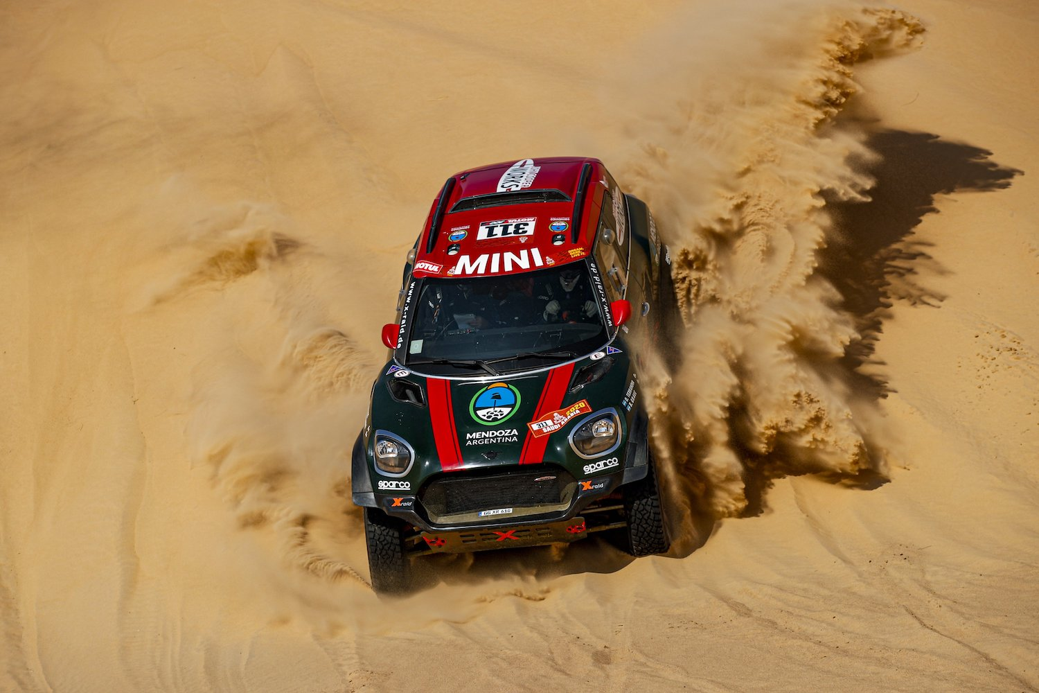 rally car on desert sand action