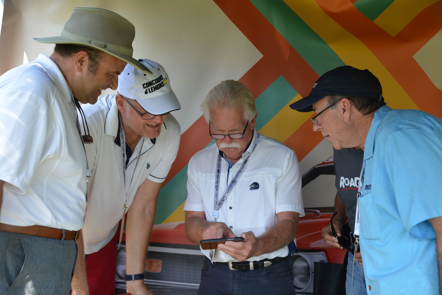 Hagerty's Doug Clark (l) confers with Concours d'Lemons Head Gasket, Alan Galbraith (white hat), Chasing Classic Cars host Wayne Carini (mustache) and tuning legend Ken Lingenfelter (r) about the finer points of picking a Worst of Show winning car.