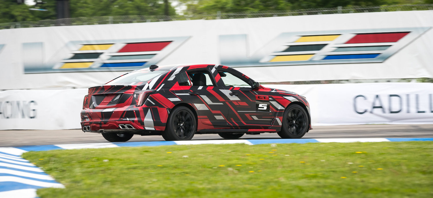 ct5-v rear three-quarter on track in motion