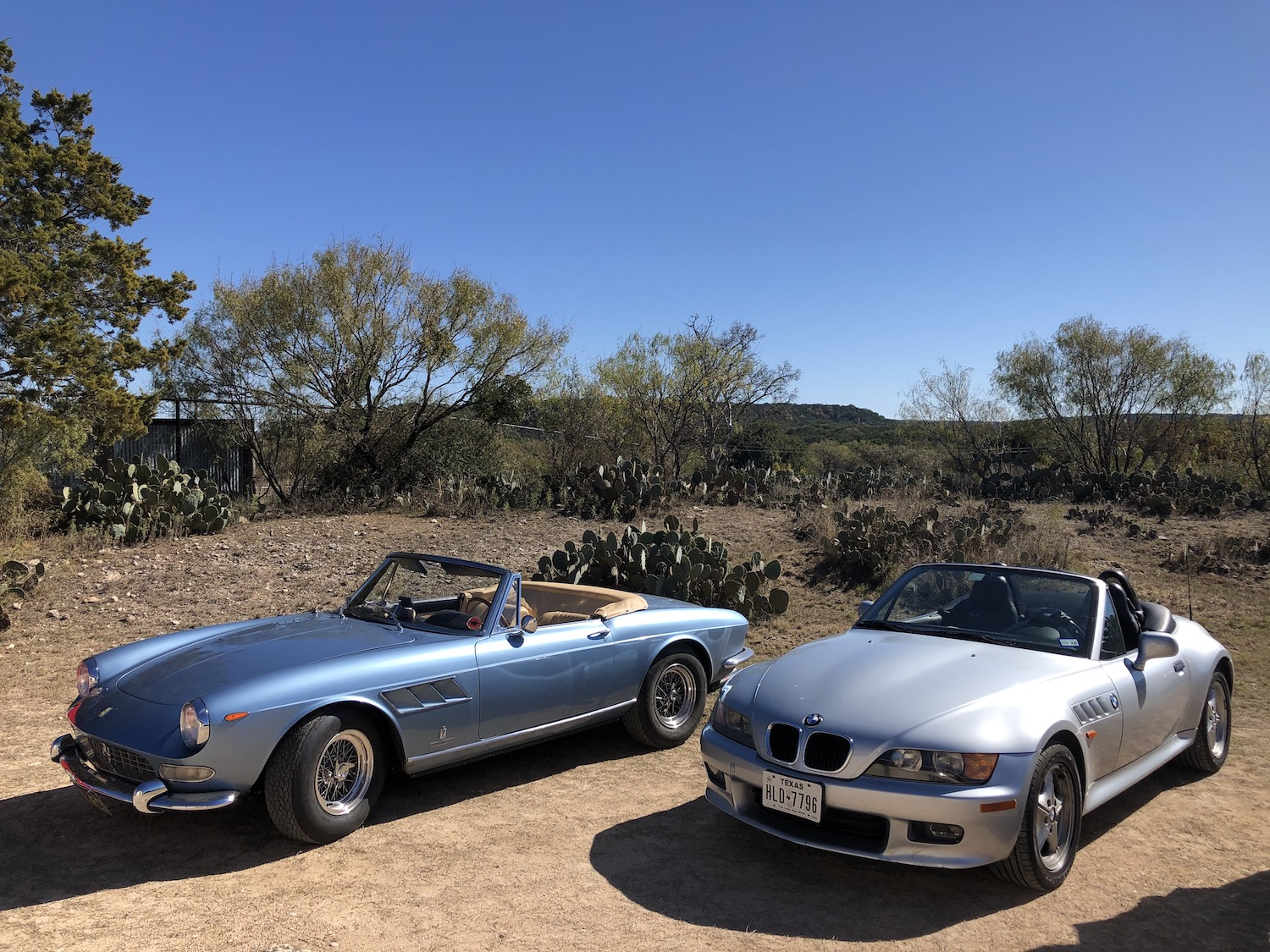bmw z3 parked on dirt beside alfa