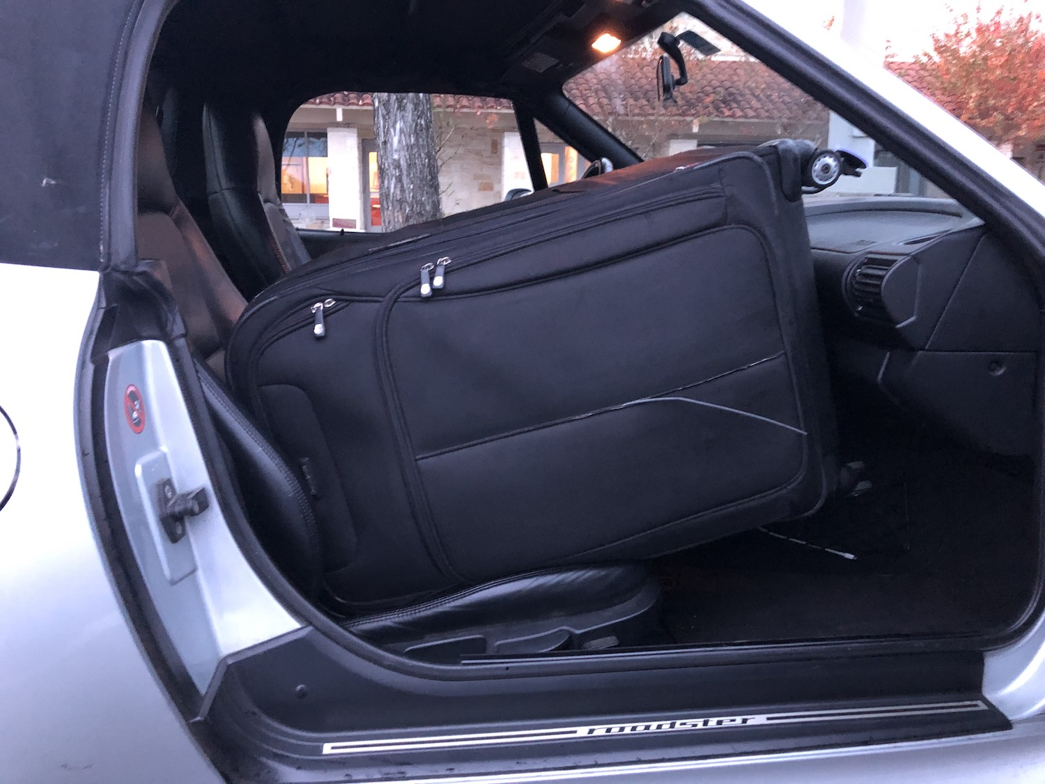 suitcase in bmw z3 front seat