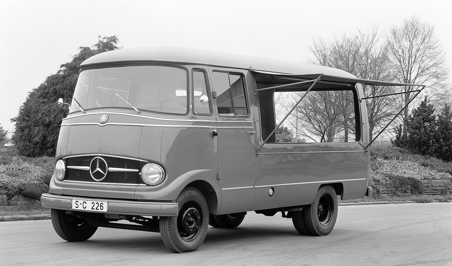 old mercedes benz mobile shop truck with awning front three-quarter