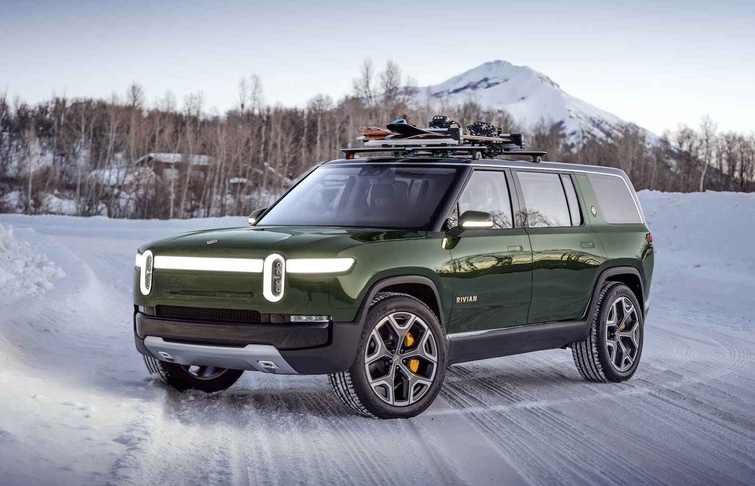 new green rivian suv front three-quarter