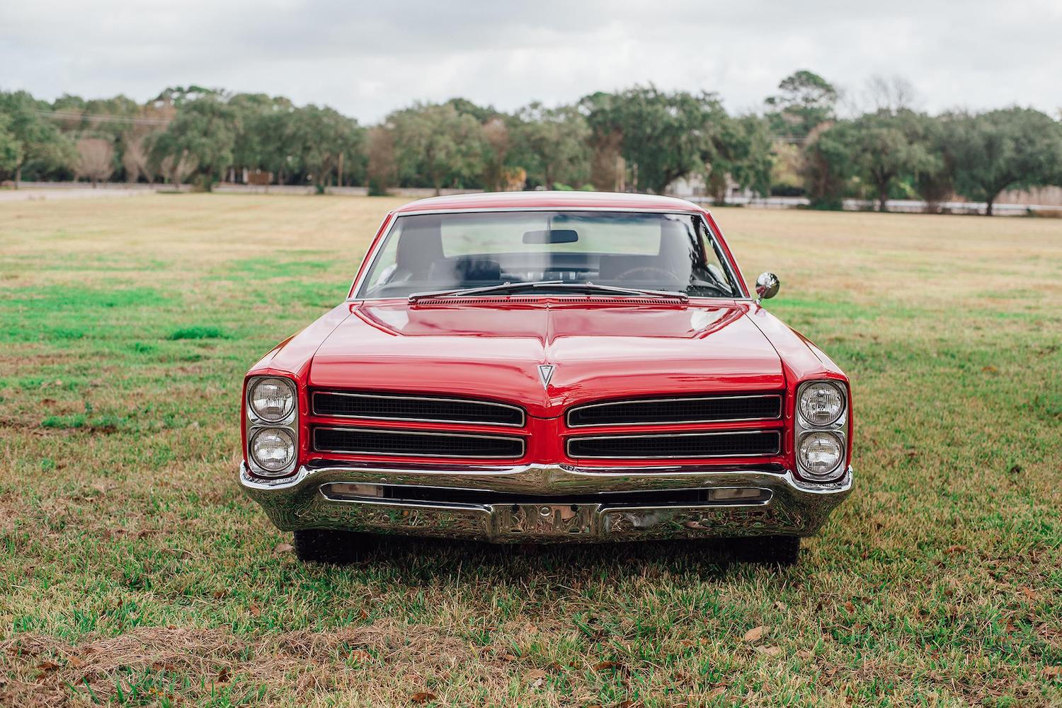 1966 red pontiac 2 plus 2 front