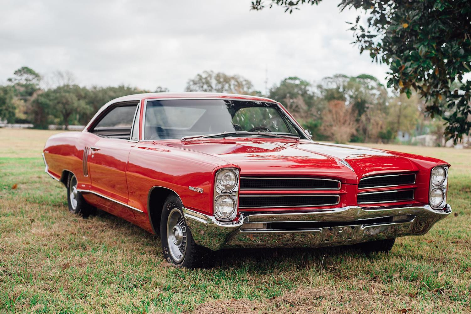 1966 red pontiac 2 plus 2 front three-quarter