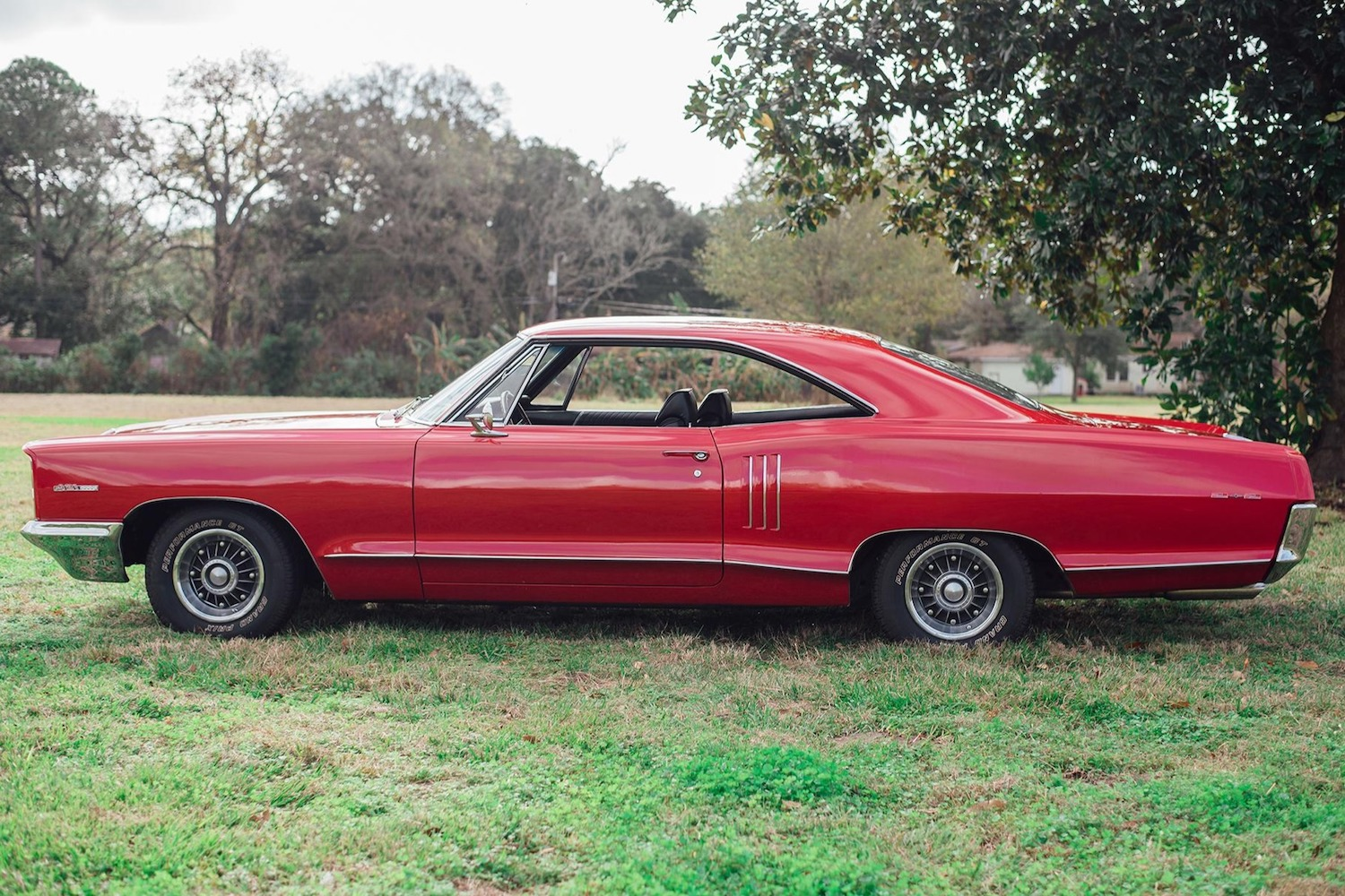 1966 red pontiac 2 plus 2 side-view