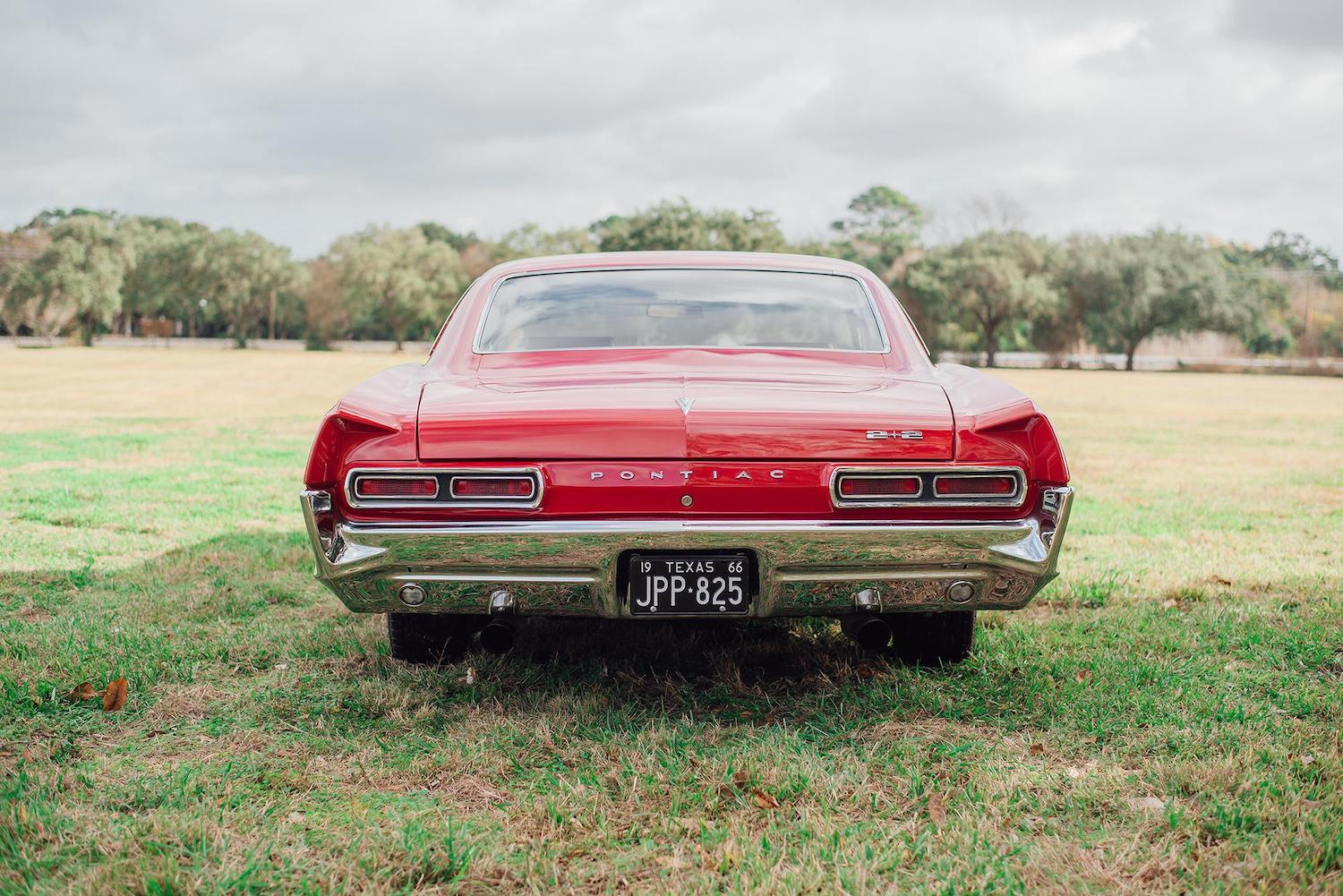 1966 red pontiac 2 plus 2 rear
