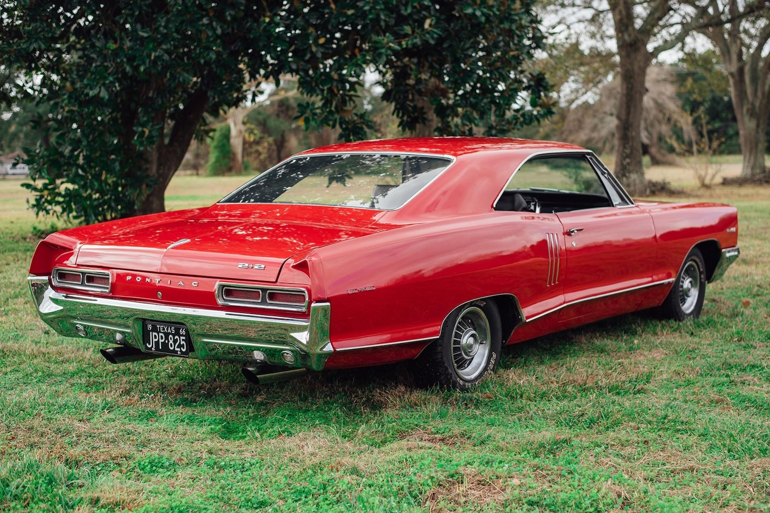 1966 red pontiac 2 plus 2 rear three-quarter