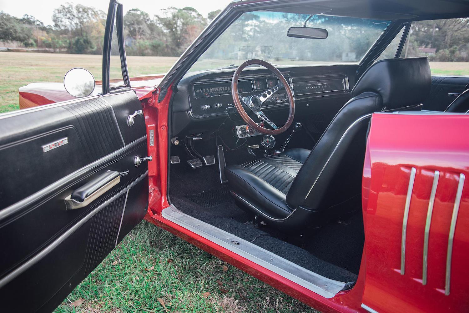 1966 red pontiac 2 plus 2 interior open door front