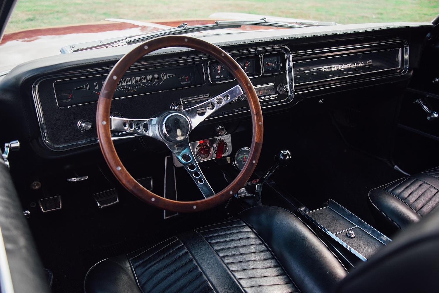 1966 red pontiac 2 plus 2 interior front dash