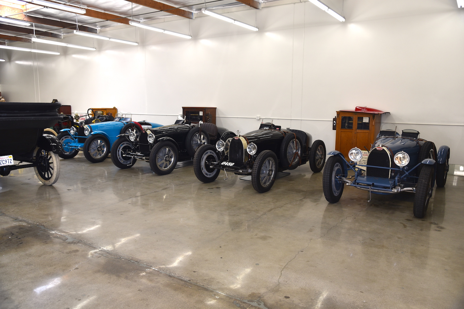 vintage bugattis in garage