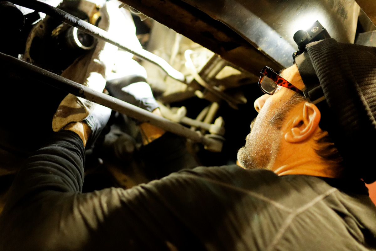 shop owner working on volvo car