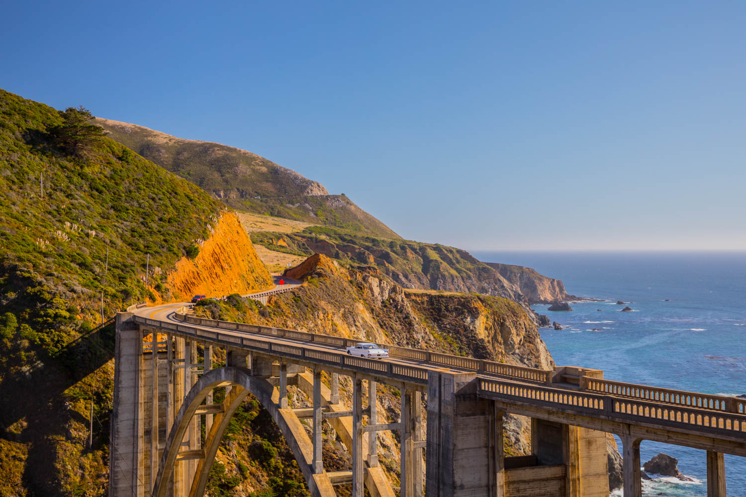 Crossing the famed Bixby Bridge on California's Highway 1, the old Newport aims for the horizon.