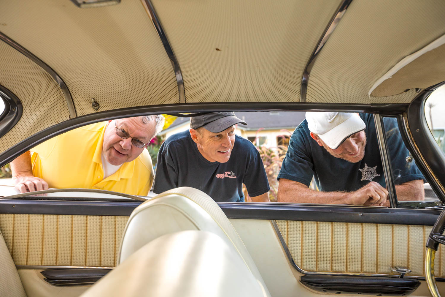 Metzelaar (from left), Stein, and Graves check out the ride for their retro road trip.