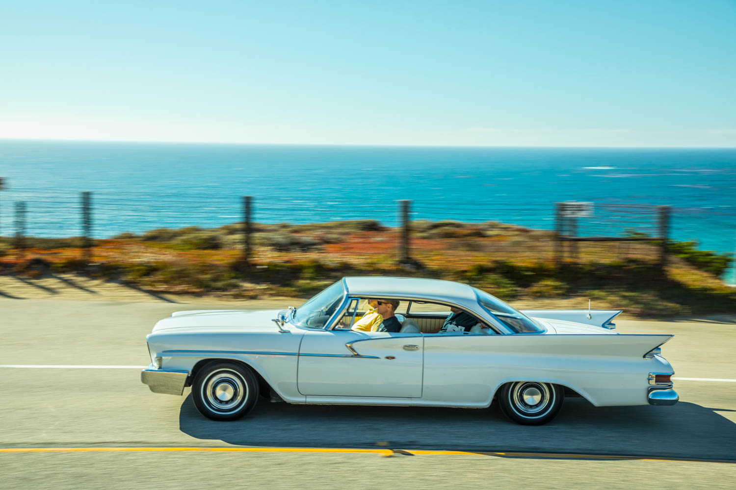 """The """"Full Size Chrysler in the New, Lower Price Range"""" wings its way down California's Pacific Coast Highway, moving our aging travelers in both space and time."""