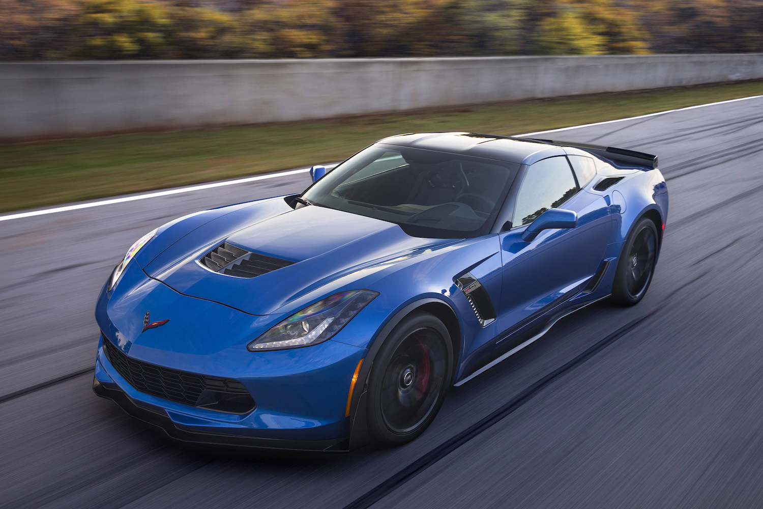 2016 blue c7 z06 corvette on track front three-quarter