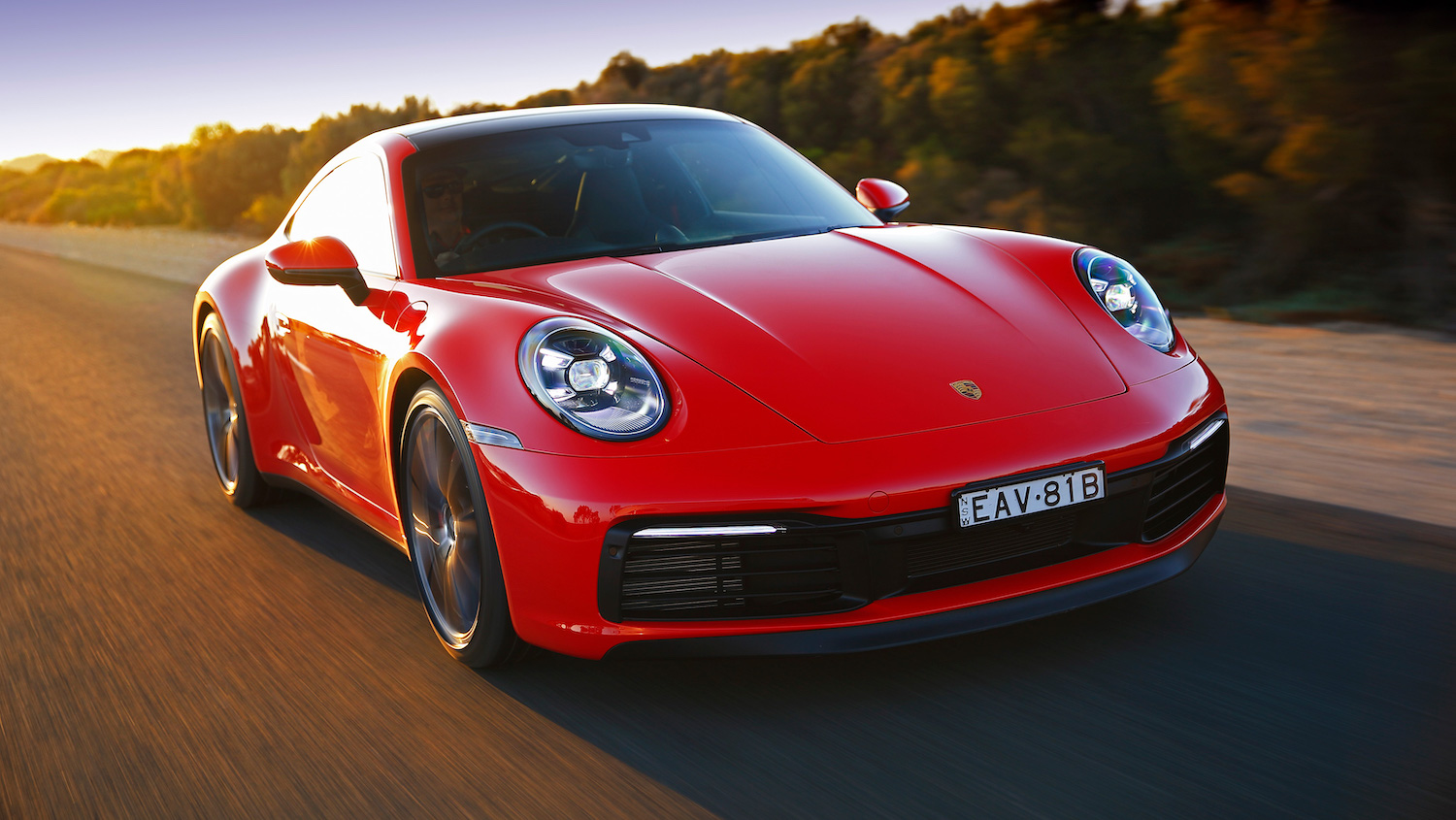 2019 red porsche 911 carrera s front three-quarter