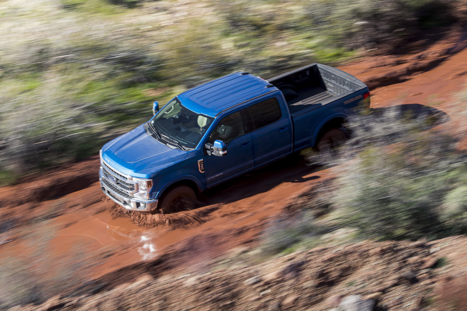 ford super duty mudding action birdseye view