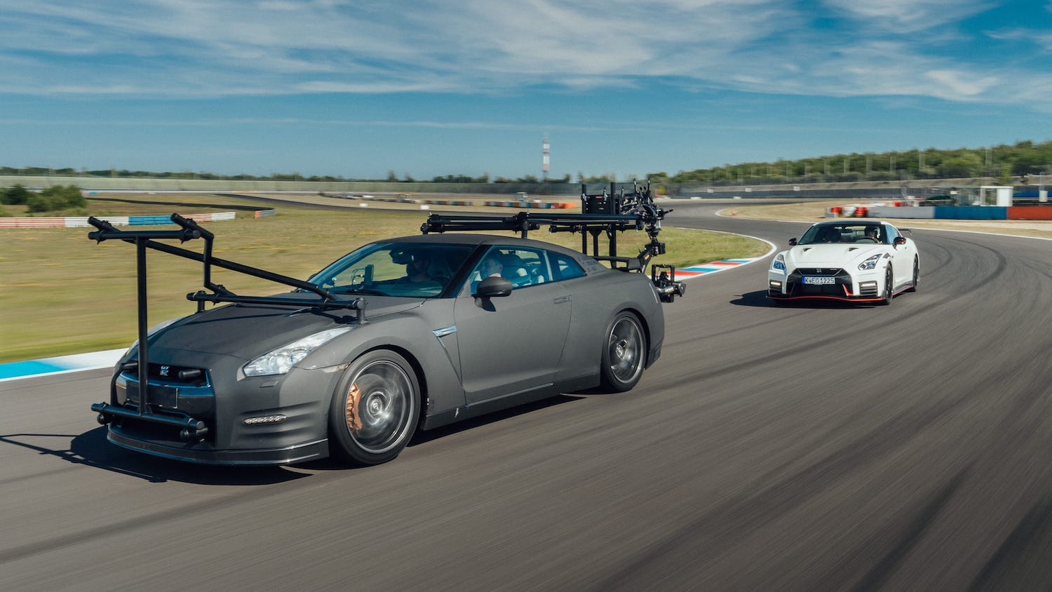 nissan gtr camera car and shot car front three-quarter on track