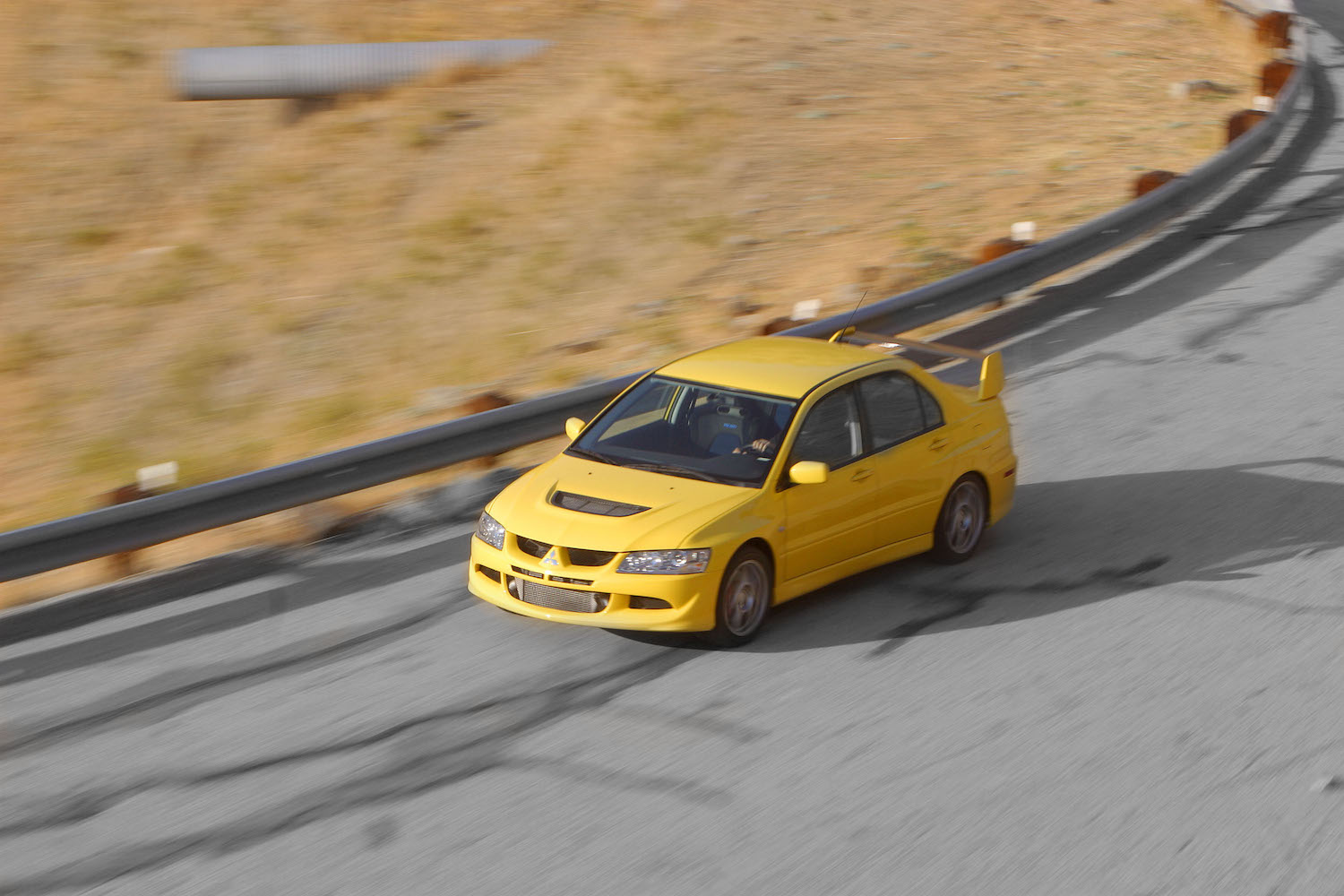 Mitsubishi evo overhead front three-quarter action in motion