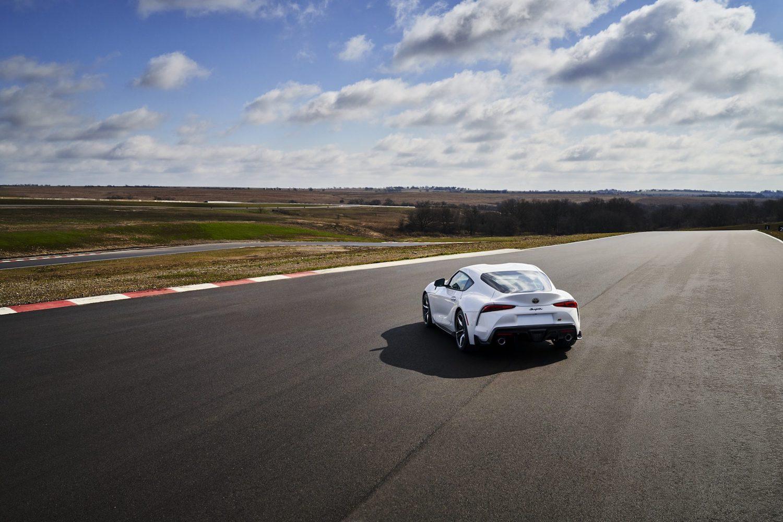 GR Supra 3.0 Premium elevated rear three-quarter on track