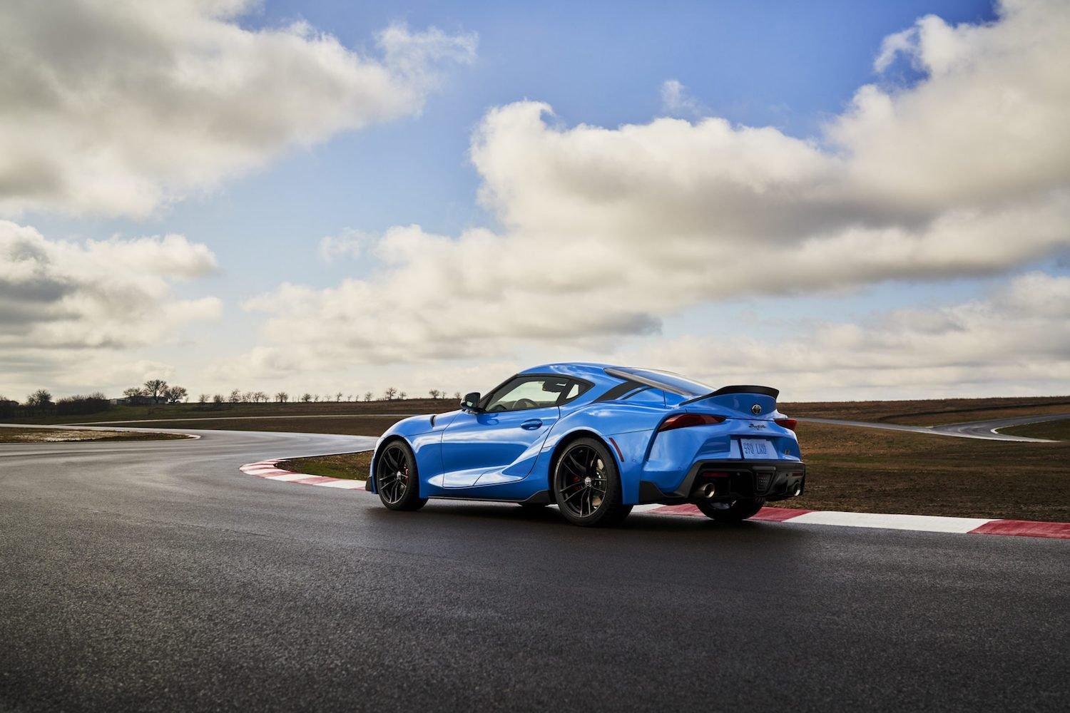 GR Supra A91 Edition rear three-quarter on track action