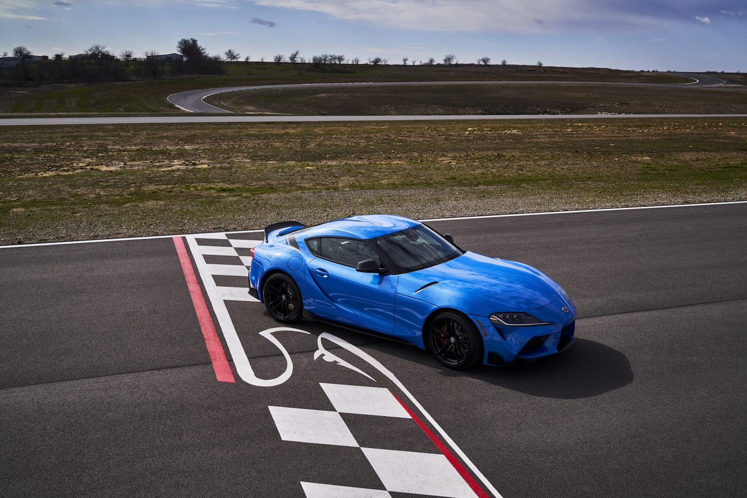 GR Supra A91 Edition elevated front three-quarter on track