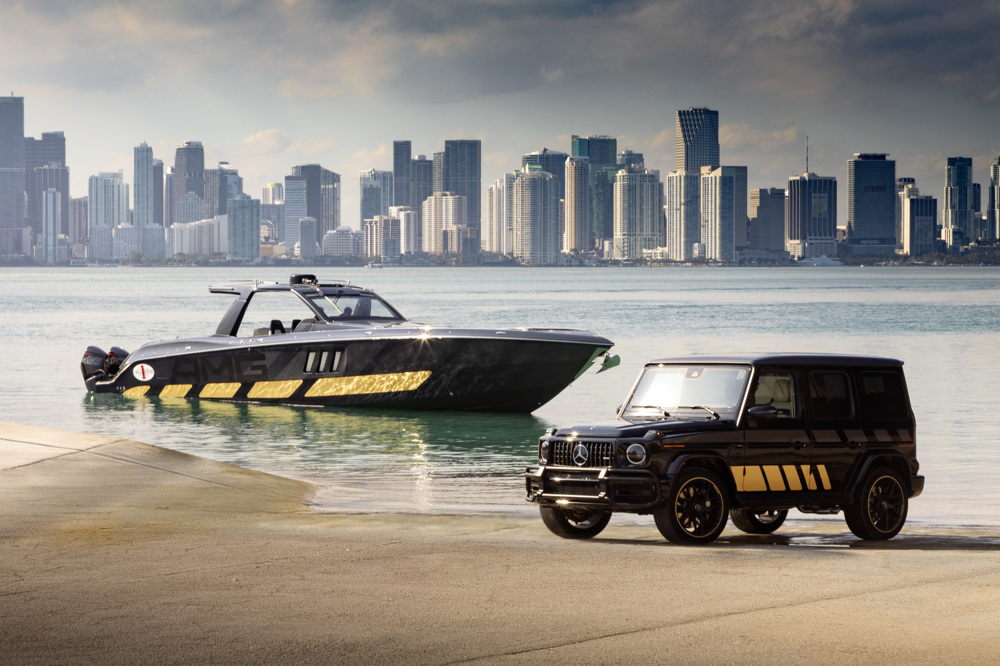 wagon front three-quarter in foreground with amg race boat background
