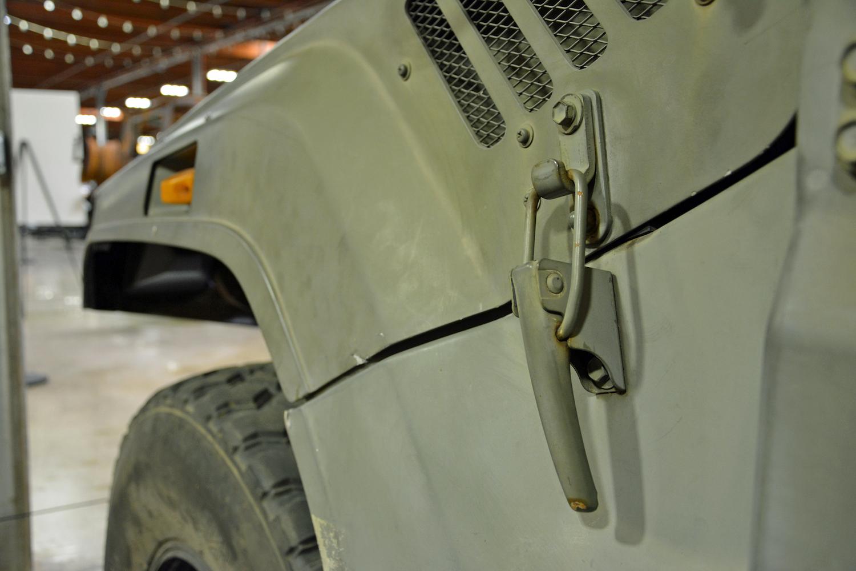 1996 BXD10 hood latch