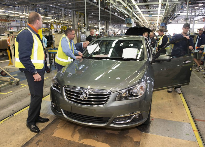 four door sedan coming off the manufacturing line