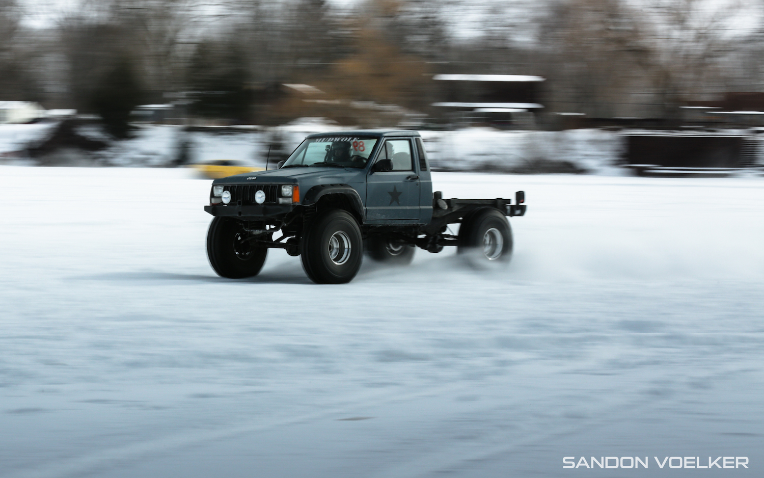 jeep comanche ice race truck front three-quarter action