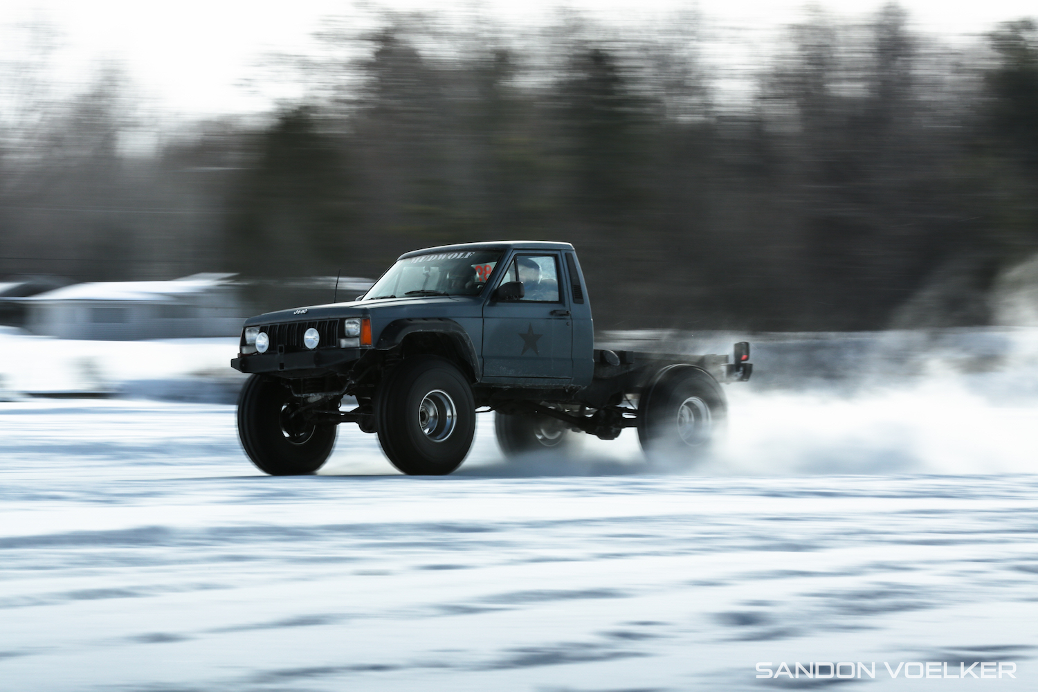 jeep comanche ice race truck wheel front three-quarter action
