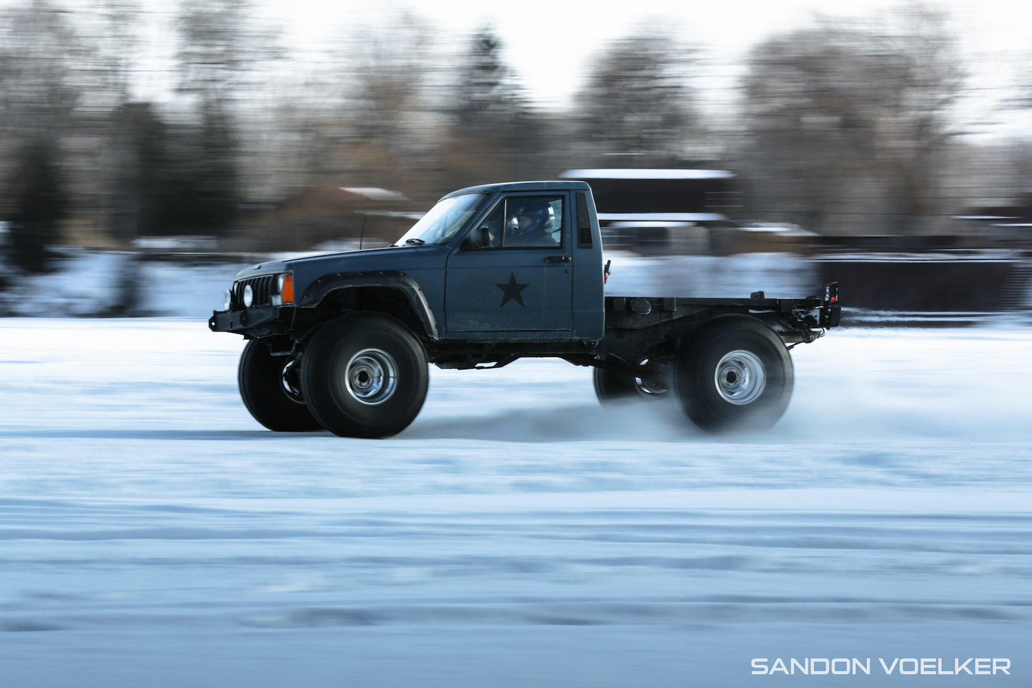 jeep comanche ice race truck side-view action
