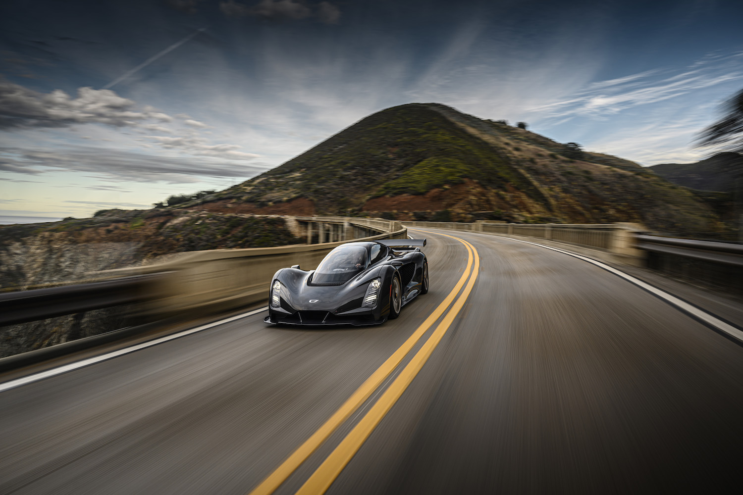 Czinger 21C 3D print hybrid supercar front three-quarter on pacific coast highway