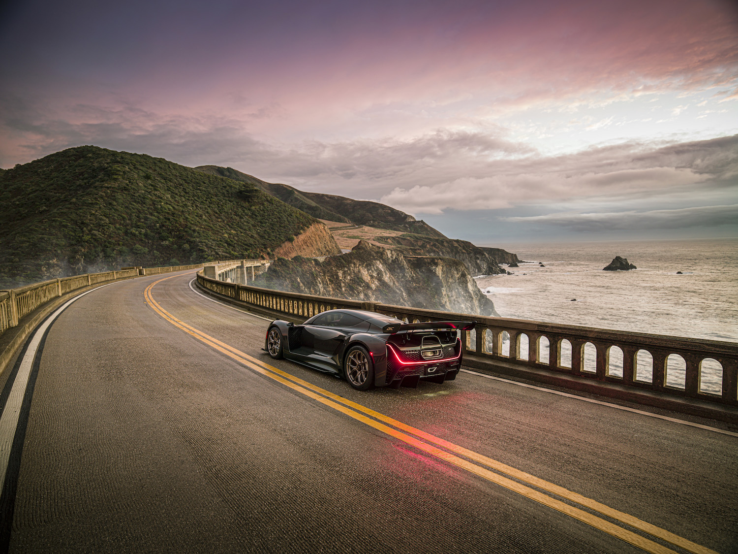Czinger 21C 3D print hybrid supercar rear three-quarter on pacific coast highway