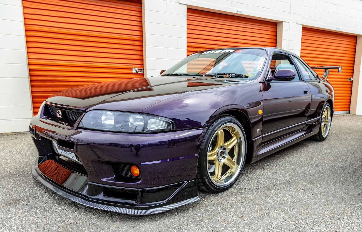 modified nissan skyline gt r front three-quarter