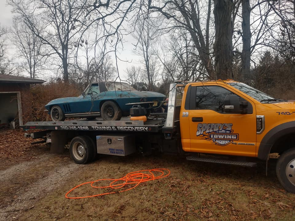 1965 numbers matching fuel injection 4 speed corvette on tow truck bed