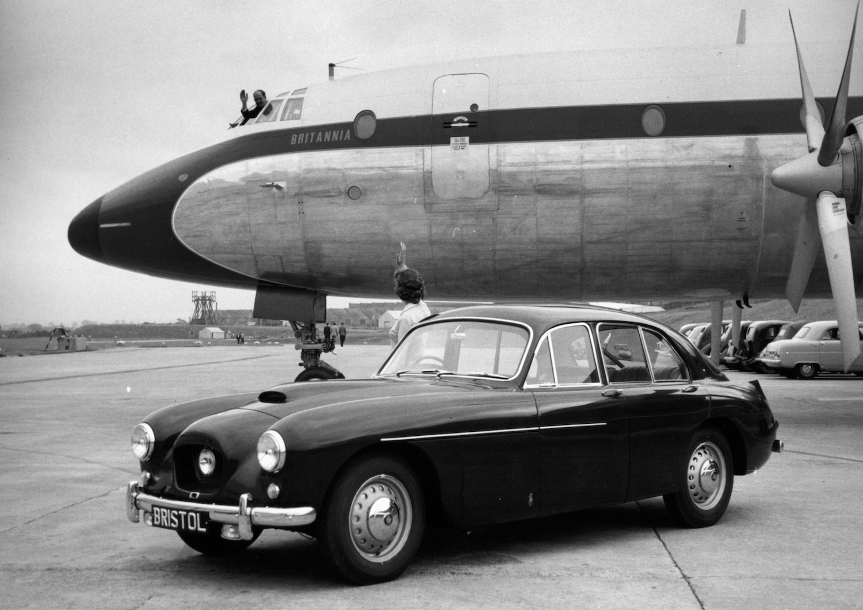 Bristol vintage car in front of jumbo jet