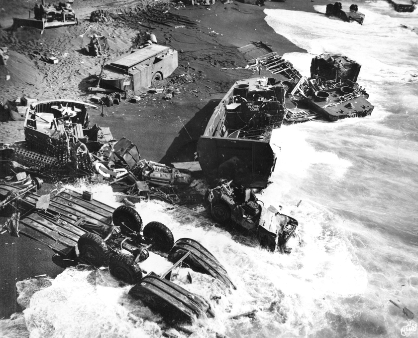 iwo jima beach littered with destroyed machines