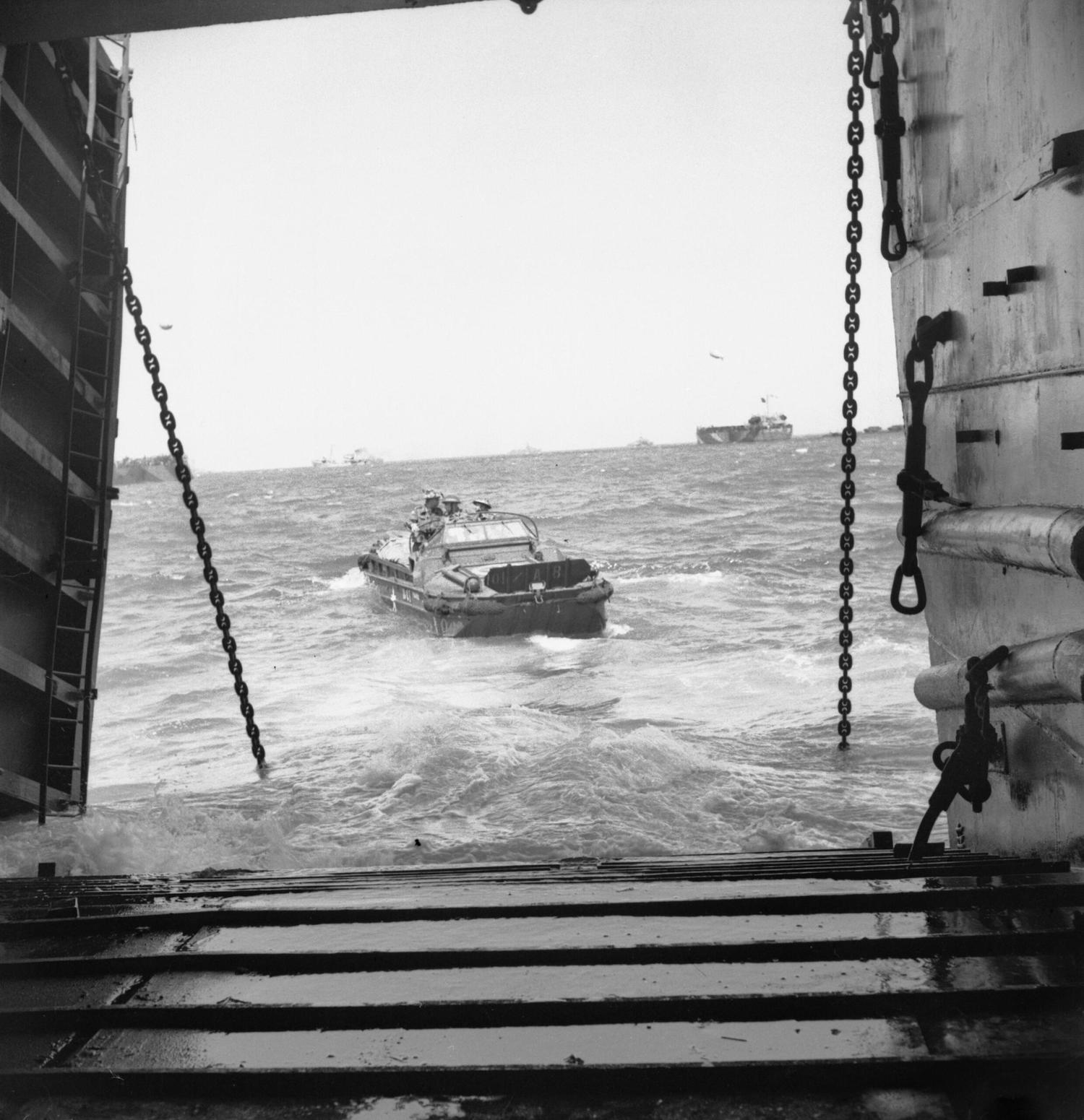 gmc dukw in water drives off ship ramp