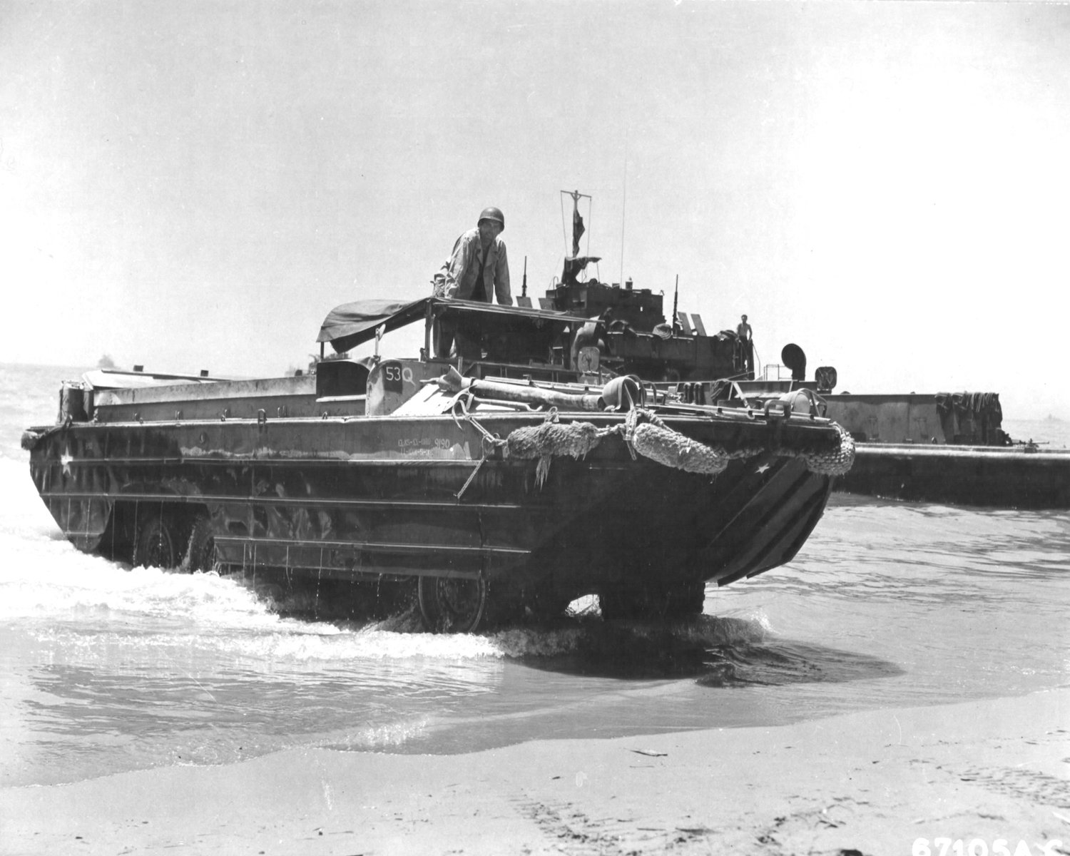 gmc dukw operator climbs beach in italy front three-quarter