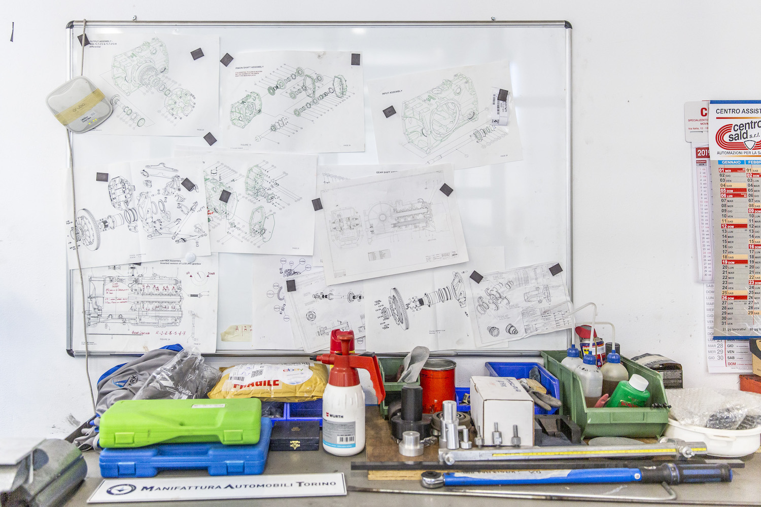 engine part assembly charts on whiteboard